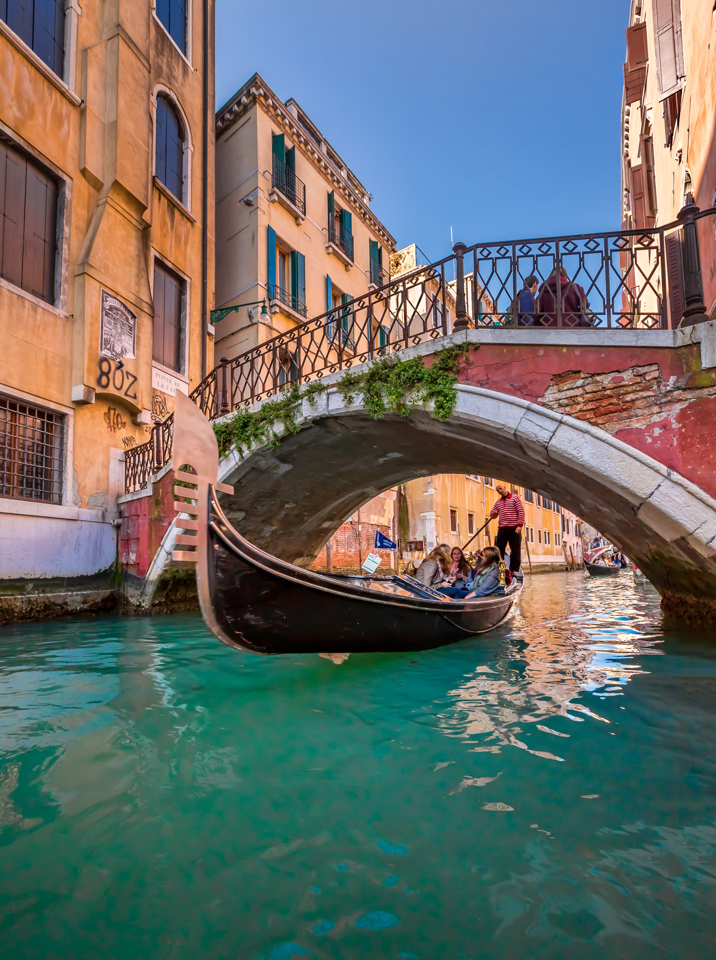 Traditional Venice Gondola Ride along Narrow Canal, Venice, Italy