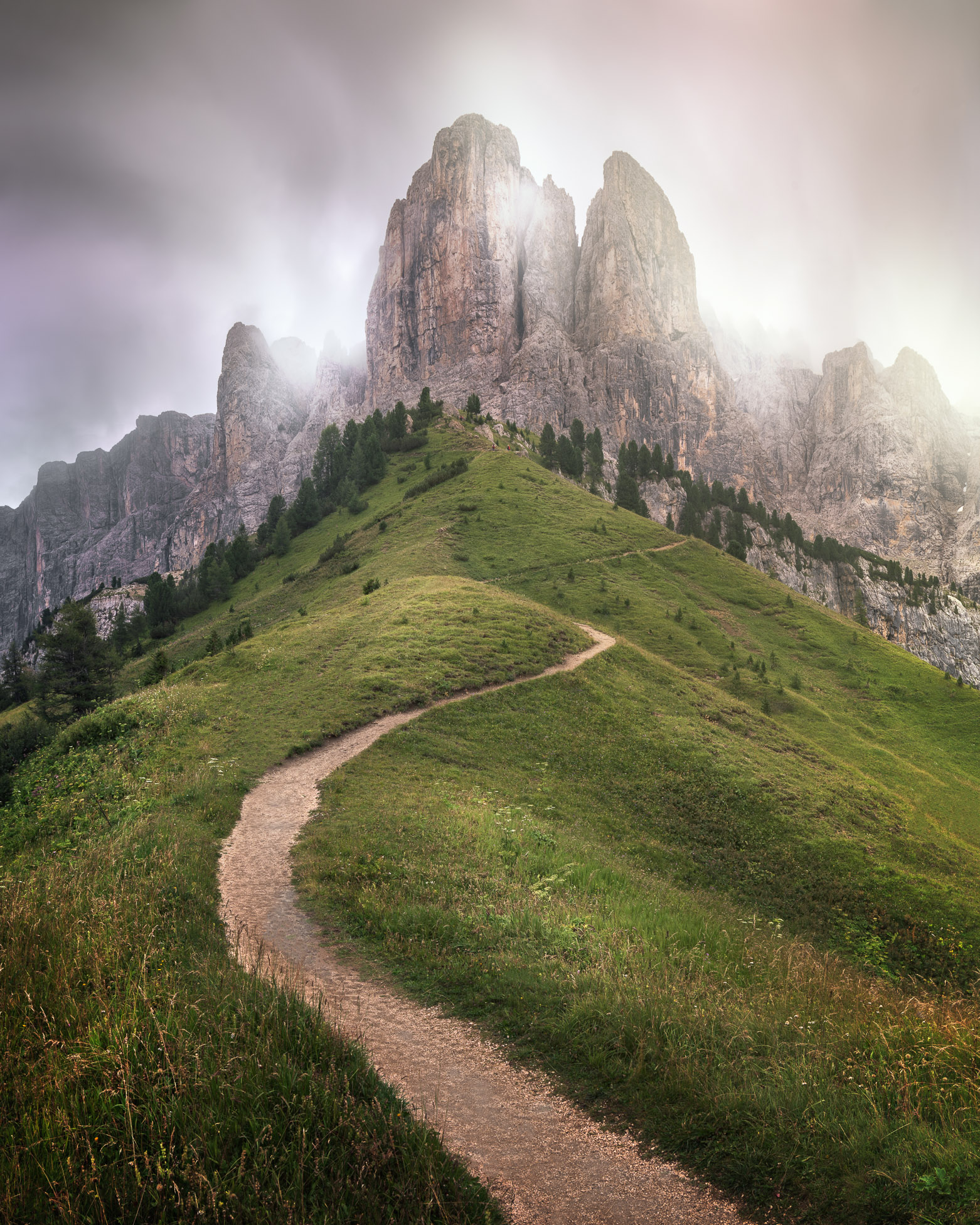 Winding path led up to Brunecker Turm mountain peak in Passo Gardena, Trentino Alto Adige, Italy