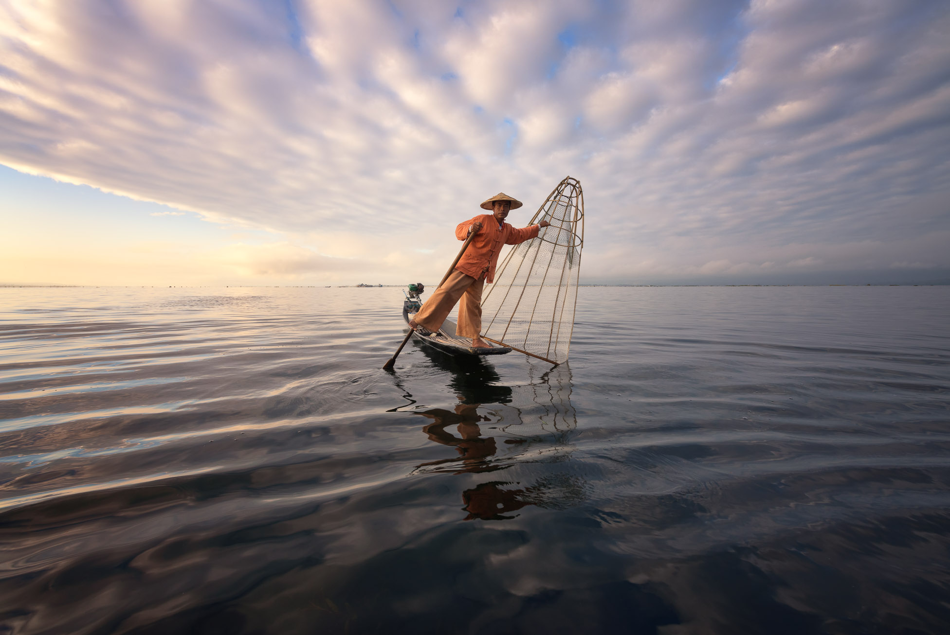 Burmese Fisherman on the Boat with Traditional Conical Net in the Morning, Lake Inle, Myanmar