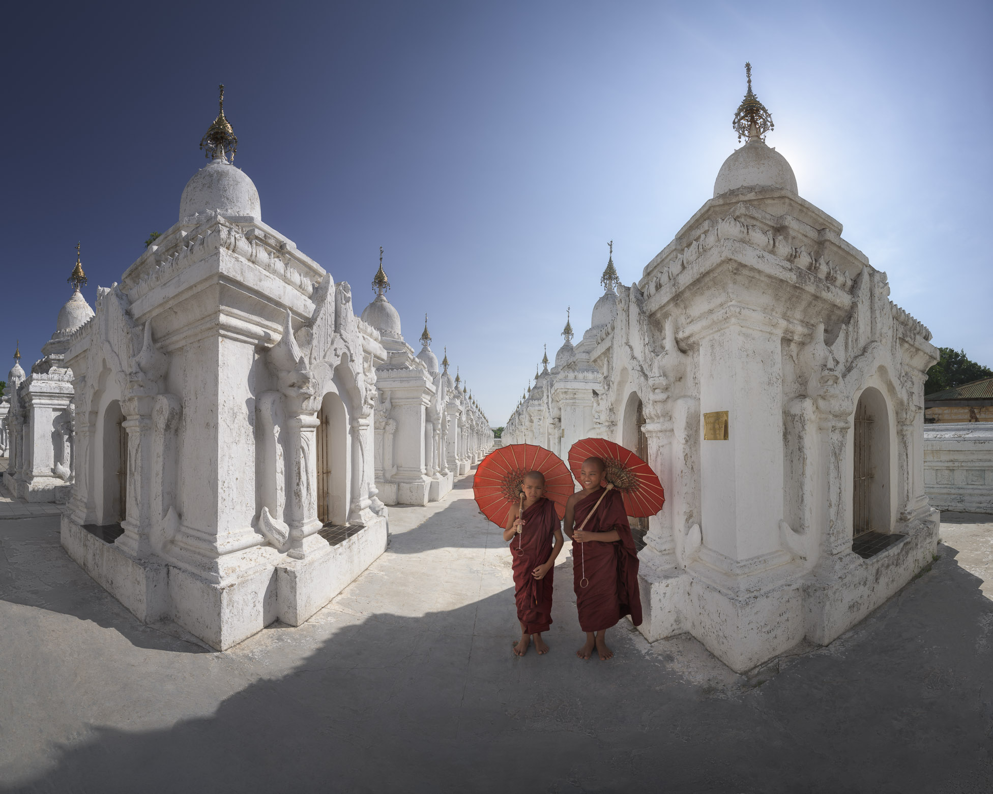 Two Monks Visiting World's Largest Book in Kuthodaw Pagoda, Mandalay, Myanmar