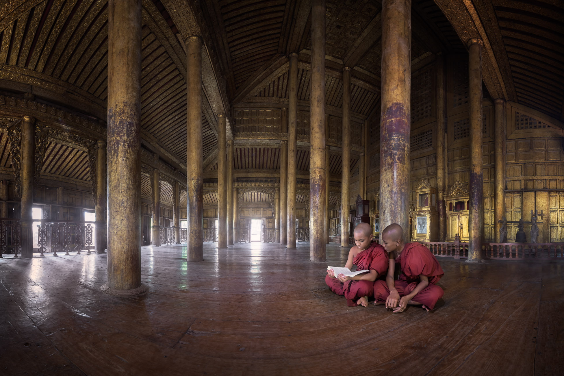 Two Monks Reading Book in Shwenandaw Monastery, Mandalay, Myanmar
