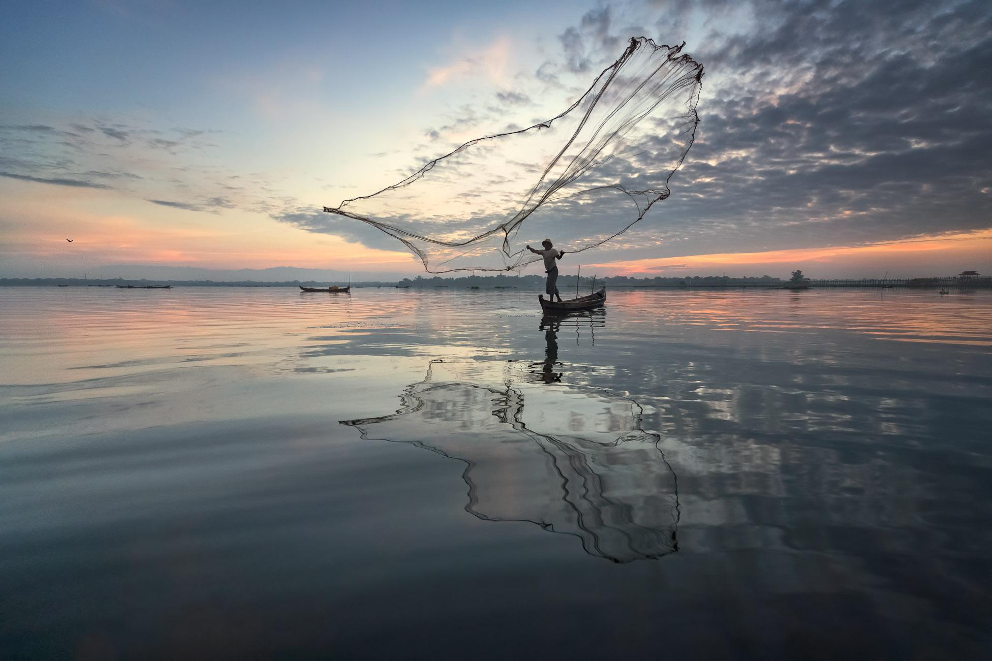 Fisherman Throwing Net Early in the Morning, Taung Tha Man Lake, Mandalay, Myanmar