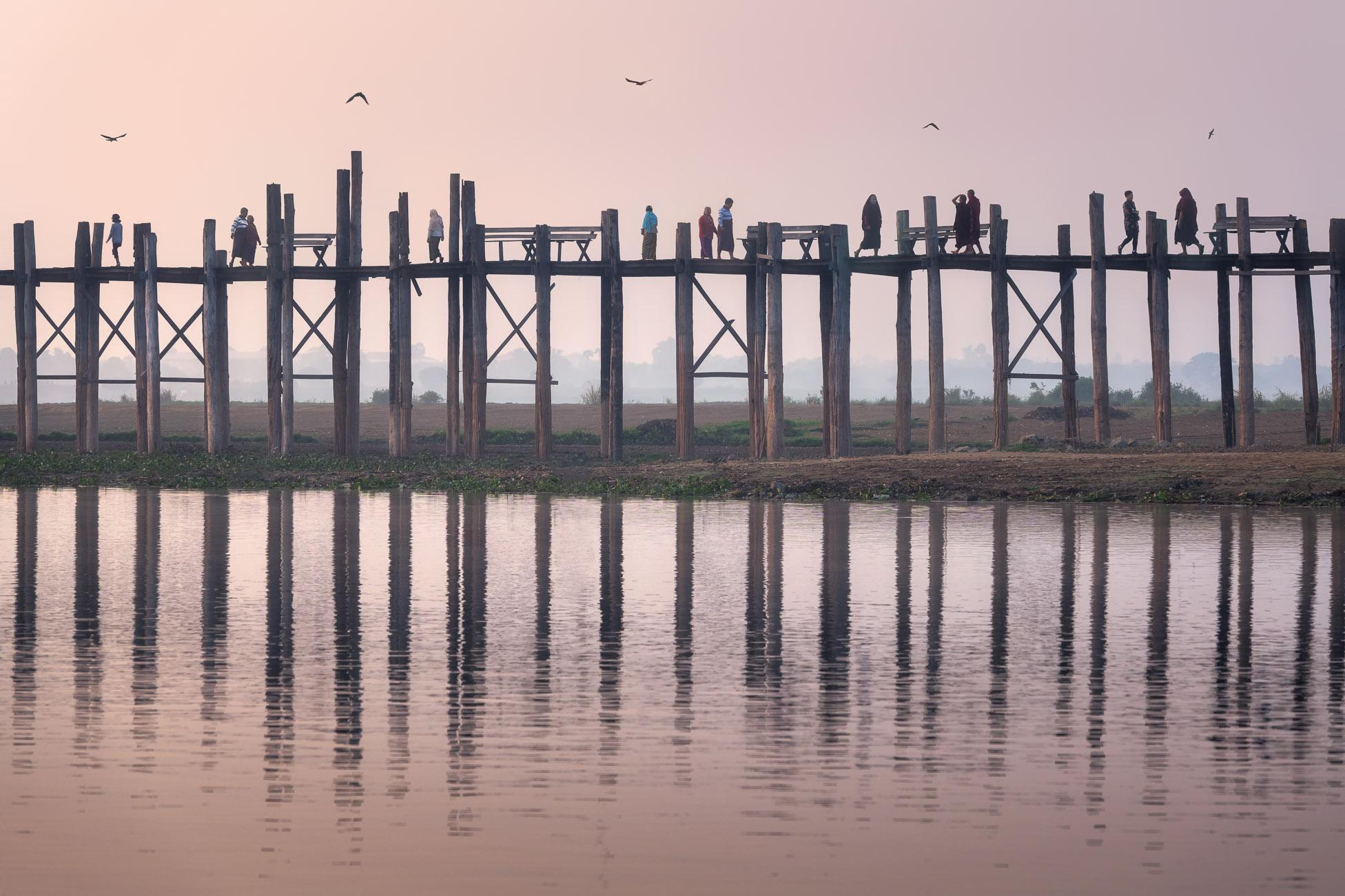 People Walking on U Bein Bridge in the Morning, Taung Tha Man Lake, Mandalay, Myanmar